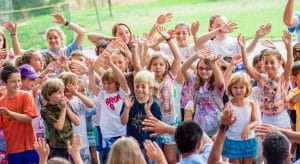 Campers with their hands in the air