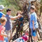 Campers build a tepee
