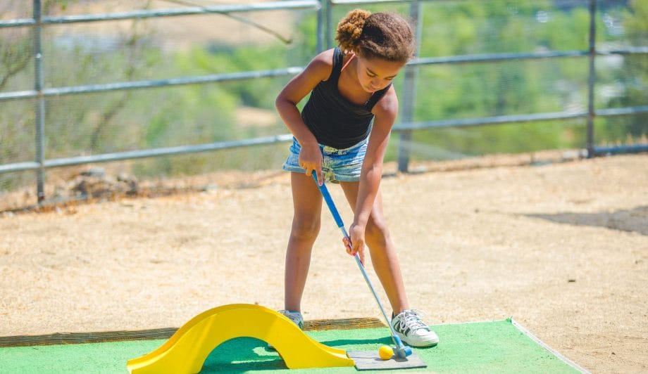 Camper playing mini golf