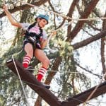 a girl rapelling on a ropes course