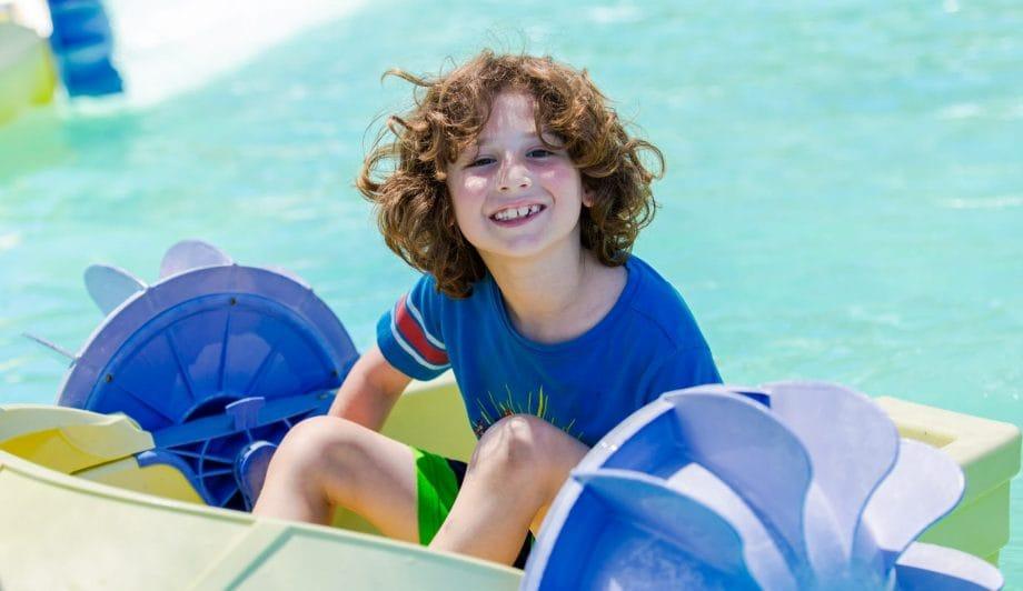 Boy on paddleboat