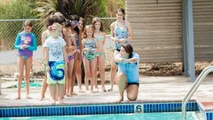 Campers learing pool instruction