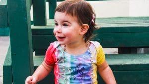 Toddler in Camp Kinneret Tie Dye Onsie