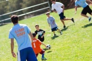 Campers playing soccer