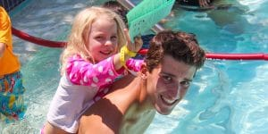 Camper and Counselor Swimming