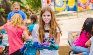 Girl making tie-dye shirt