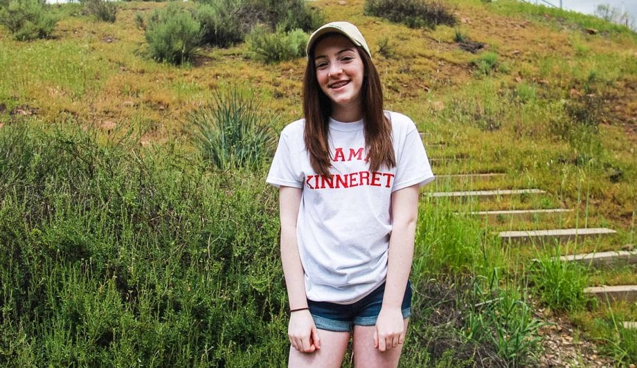 Girl in Camp Kinneret Shirt