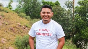 Male in Camp Kinneret Shirt