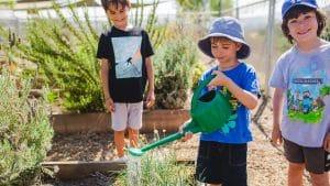 Campers watering plants