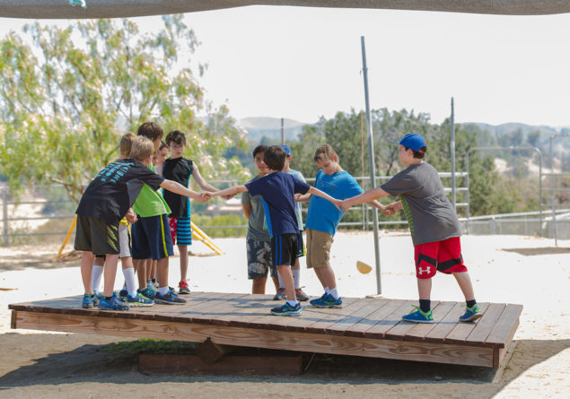 Campers balancing on balance board