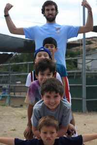 A counselor imitating a totem pole with campers